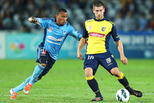 Yairo Yau of Sydney FC (left) and Nick Montgomery of the Mariners. Photo / Getty Images