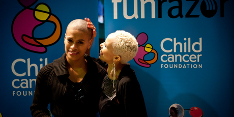Megan Alatini admires Vilomena Ole's shaved head yesterday. Pictures / Dean Purcell