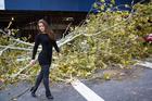 Former <i>Playboy</i> model Nana Gouvea poses amid debris from the storm. Photo / Supplied