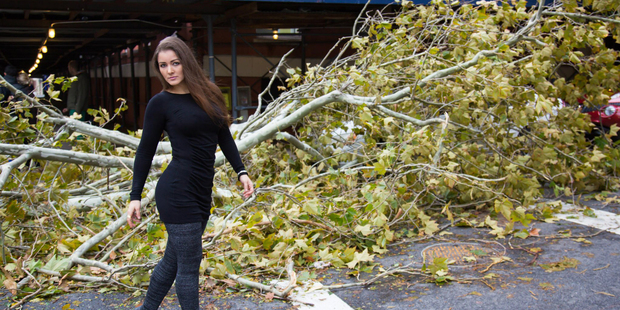 Former  Playboy  model Nana Gouvea poses amid debris from the storm. Photo / Supplied