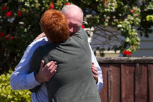 Family members console each other. Pictures / Brett Phibbs