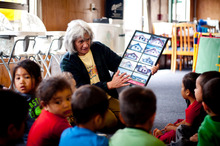 Hera Tiakiwai teaches pre-school children at the Te Tira Hou Marae in Panmure. Photo / Dean Purcell