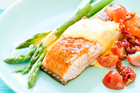 Grilled Regal salmon with asparagus, citrus hollandaise and tomato duo. Photo / Kieran Scott