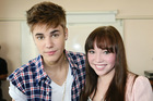 Justin Bieber, pictured with Starship patient Makenzie Perry, is helping to promote the hospital's festive-season album.