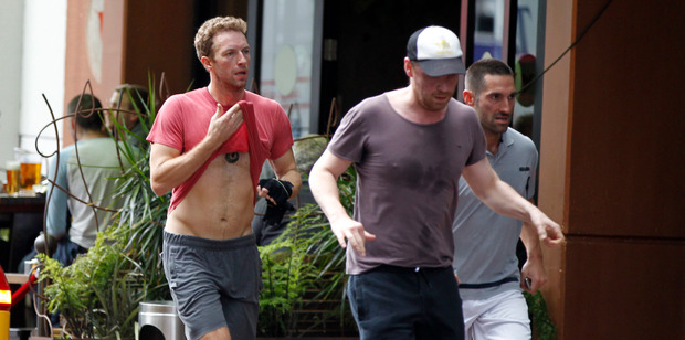 Coldplay frontman Chris Martin and guitarist Jonny Buckland work up a sweat. Photo / Michael Craig