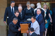 Greg King's casket is carried down the steps of the Wellington Cathedral of St Paul, followed by his wife Catherine Milnes-King. Photo / Mark Mitchell