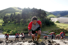 Manu Vatuvei leads players up a sand dune at Bethells yesterday. Photo / Michael Craig