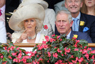Camilla, Duchess of Cornwall and Prince Charles, Prince of Wales watch the racing as they attend the Melbourne Cup at Flemington Racecourse, yesterday. Photo / Getty Images