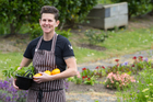 Chef Sara Simpson of the Tasting Shed, Kumeu, in the kitchen garden. Photo / Richard Robinson