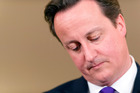 British Prime Minister David Cameron is under heat for his close links with former News International CEO Rebekah Brooks. Photo / AP