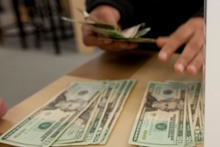 Carrying a lot of cash is risky, especially in poorer countries. Photo / AP 