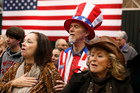 Supporters of Mitt Romney pray before the arrival of their candidate at a campaign rally in Cleveland. Photo / AP