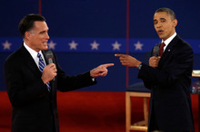 Republican presidential candidate Mitt Romney (left) and President Barack Obama spar during the second presidential debate.  Photo / AP