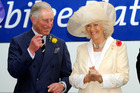 Prince Charles and his wife Camilla, the Duchess of Cornwall wait to present the Diamond Jubilee Plate at the Melbourne Cup. Photo / AP