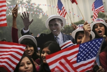 Students react next to a cardboard cutout of President Barack Obama. Photo / AP