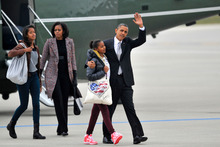 President Barack Obama with daughters Sasha, second from right, Malia, left, and first lady Mich