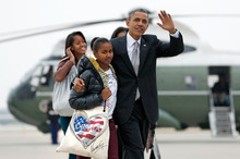 President Barack Obama walks with daughter Sasha as, first lady Michelle Obama walks with Malia. Photo / AP