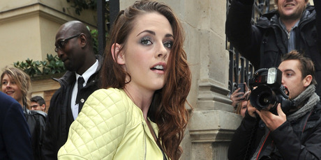 Kristen Stewart is keen to keep fans guessing about her relationship with Robert Pattinson. Photo / AP