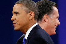 Republican presidential candidate Mitt Romney and President Barack Obama walks past each other on stage at the end of the last debate at Lynn University. Photo / AP
