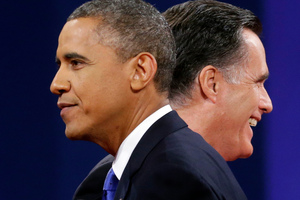 Mitt Romney and President Barack Obama walks past each other on stage at the end of the last debate. Photo / AP