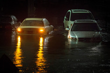 Vehicles are submerged during Superstorm Sandy in New York. Photo / AP