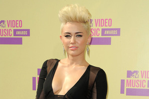 Miley Cyrus is engaged to Aussie actor Liam Hemsworth.Photo / AP