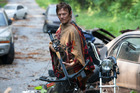 Daryl Dixon, played by Norman Reedus, gets ready for some zombie action in The Walking Dead. Photo / Supplied