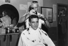 Elvis Presley gets his pre-Army haircut. Photo / AP