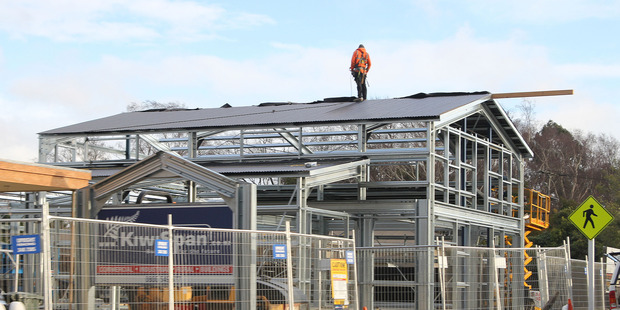A new shop being built in Christchurch. A lift in labour pay rates in Canterbury pushed up national figures released by Statistics NZ today. Photo / Geoff Sloan