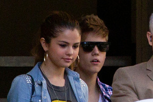 Selena Gomez with Justin Bieber in Auckland earlier this year. Photo / AP