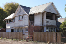 An earthquake damaged house on Hereford St. Photo / Geoff Sloan