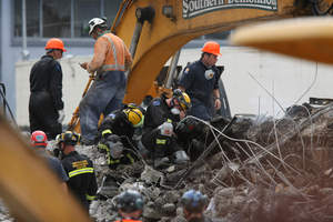 International Rescue crews look for bodies at the CTV Building. Photo / NZ Herald