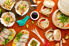 (Clockwise top left) Fried rice; crab, garlic chive dumplings; and Vietnamese rice paper rolls. Photo / Babiche Martens