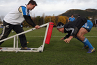 Cory Jane and Israel Dagg of the All Blacks runs through drills during a training session at Peffermill University. Photo / Getty Images.