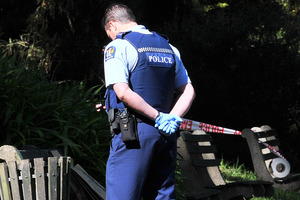 A police officer guards the site where the body of a Dunedin man was found in the Dunedin Botanic Garden early yesterday. Photo / Jane Dawber