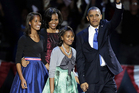 President Barack Obama waves as he walks on stage with first lady Michelle Obama and daughters Malia and Sasha at his election night party. Photo / AP