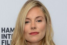 Sienna Miller posed naked when she was pregnant. Photo / AFP