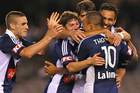 The Victory celebrate one of their three goals against the Phoenix. Photo / Getty Images