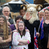 Royal fans wait in the rain to catch a glimpse of His Royal Highnesses The Prince of Wales and the Duchess of Cornwall during their short visit to lower Queen Street. Photo / Greg Bowker