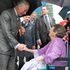 The Prince of Wales chats with 96-year-old Violet Hollis who he shares a birthday with during his short visit to lower Queen Street. Photo / Greg Bowker