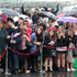 People wait at the side of the road to greet Prince Charles and his wife on Queen Street in Auckland today. Photo / Steven McNicholl
