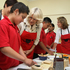Camilla dons an apron in the East Tamaki school kitchen to view their Garden to Table curriculum. Photo / Natalie Slade
