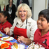 Camilla enjoys a piece of carrot cake made in East Tamaki school's kitchen as part of their Garden to Table curriculum. Photo / Natalie Slade