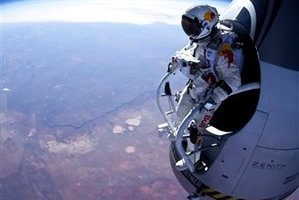 Felix Baumgartner prepares to jump during the first manned test flight for Red Bull Stratos. Photo / AP