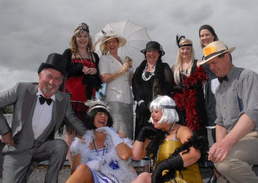CUP DAY: The Roaring 20s were alive and well at Masterton accountancy firm Sellar & Sellar in Queen St yesterday, with staff dressing up in feather boas and bow ties to celebrate the running of the Melbourne Cup.