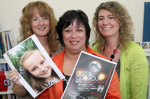 PARTY MOOD: St Pat's teachers Erena Mccann (left), Jaquie Simmonds and Jane Cayless are part of the charity group in Masterton throwing the Glitz and Glamour Ball as a fundraiser for stricken Carterton schoolgirl Grace Yeats.