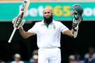 South Africa's Hashim Amla reaches his century during day three of the first cricket test between Australia and South Africa. Photo / AP