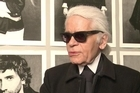 Iconic fashion designer Karl Lagerfeld inaugurates his star-studded photo exhibition devoted to the little black jacket created by Coco Chanel in 1954.