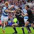 Scotland player David Denton brushes past Richie McCaw. Photo / Getty Images