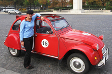 The often-photographed tour guide Marie and her 2CV in the Place du Trocadero. Photo / Rob McFarland